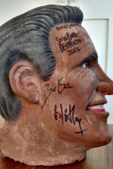 ORIGINAL STAGE USED PROP: Mitt Romney's decapitated head, signed by the band!